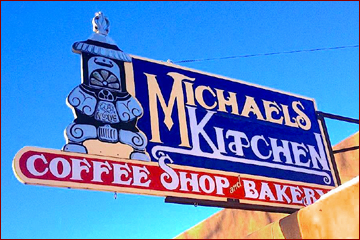 Michael's Kitchen sign over the historic adobe building in the center of Taos has been an icon since the 1970s. Locals and tourists alike gather here for the best breakfast in Taos, fantastic Mexican fare, and fresh baked pastries.