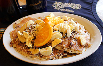 Pecan pancakes with bananas and oranges is a favorite at Michael's Kitchen, where they serve breakfast all day!