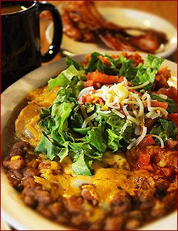 This delicious combination enchilada, burrito and flour taco plate with rice and beans is a work of art!